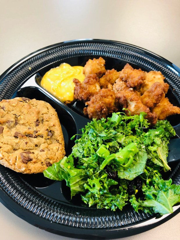 Chicken nuggets, spinach and kale salad, cookie