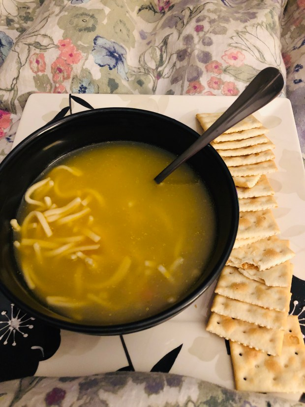 Chicken and noodle soup and crackers