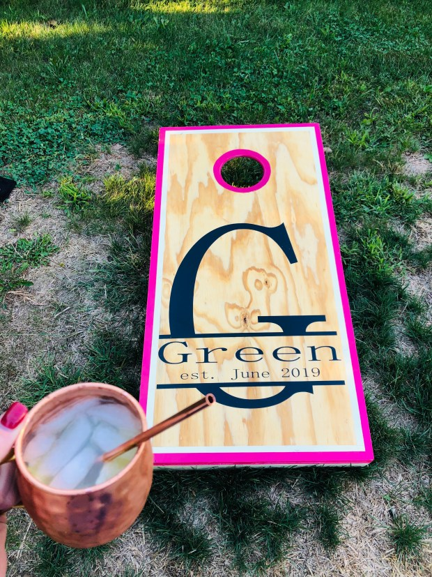 Cornhole and moscow mules in the backyard