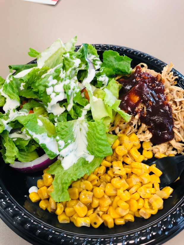 Salad, corn, and chicken
