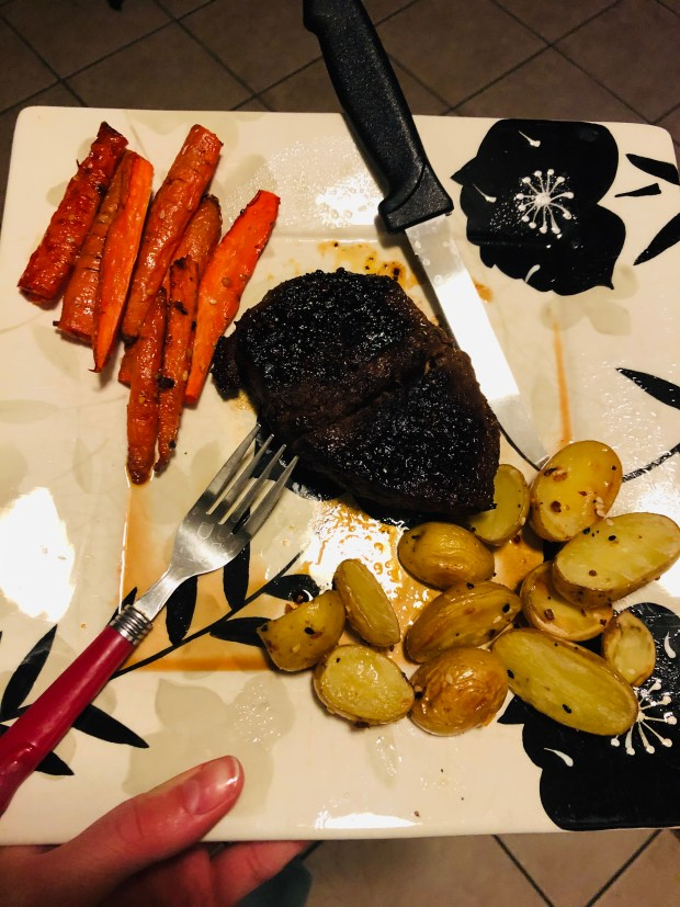 Steak, roasted carrots and potatoes for dinner