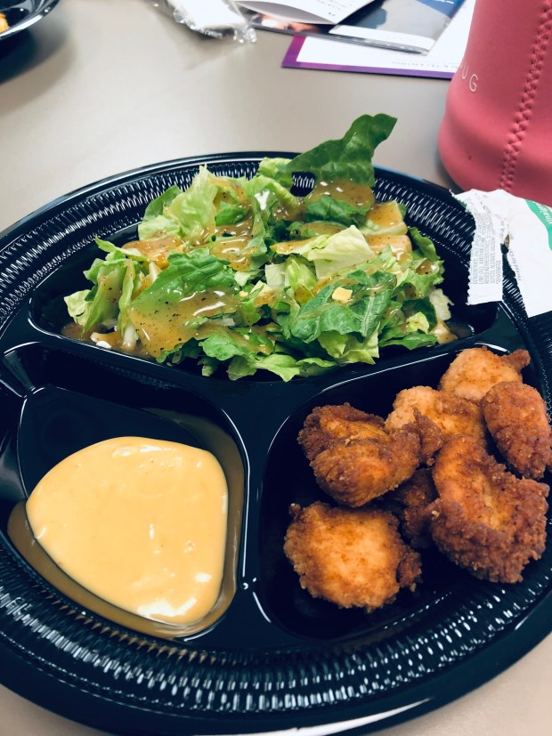 Salad and chicken nuggets