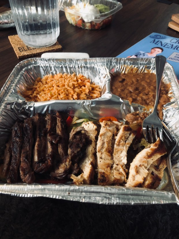 Chicken and steak fajitas with rice and beans