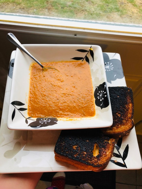 Homemade tomato soup and grilled turkey and cheese sandwich
