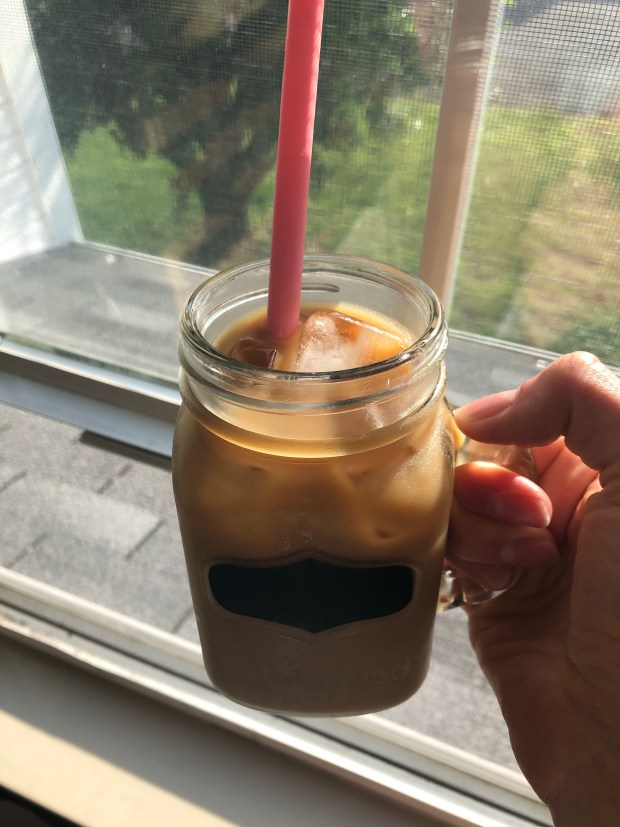 Iced coffee by window