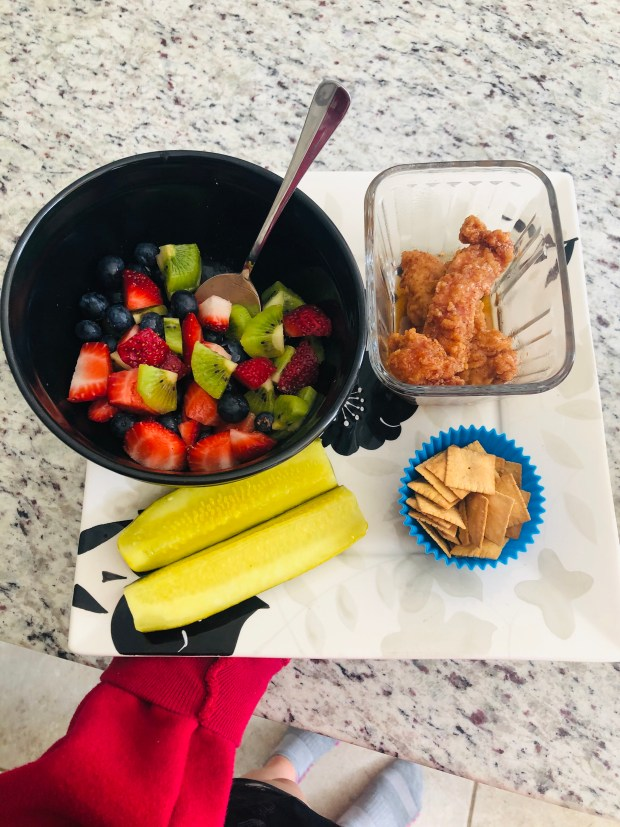 Fruit, chicken tenders, pickles, and cauliflower crisps