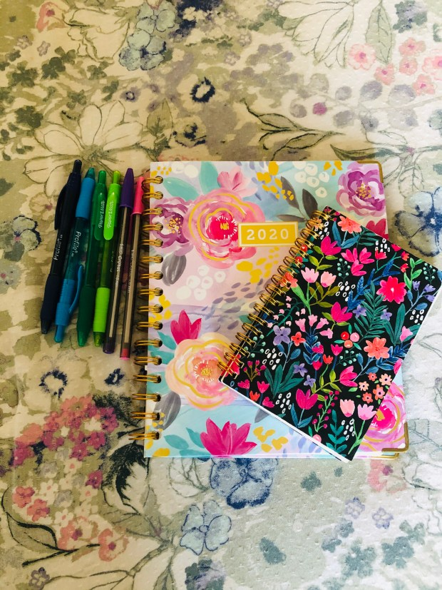 Planner and colorful pens