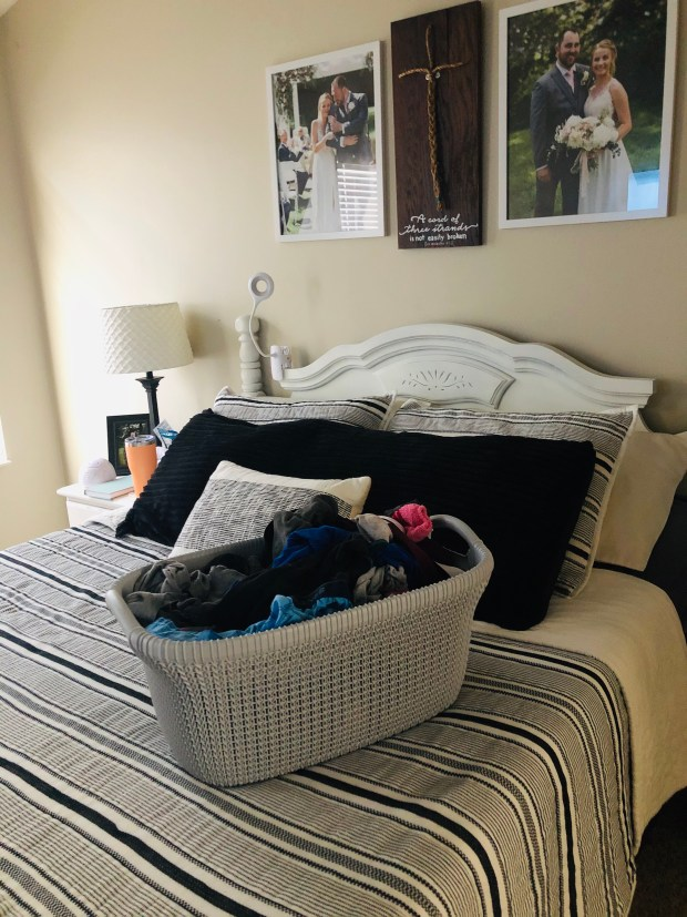 Full laundry basket on bed