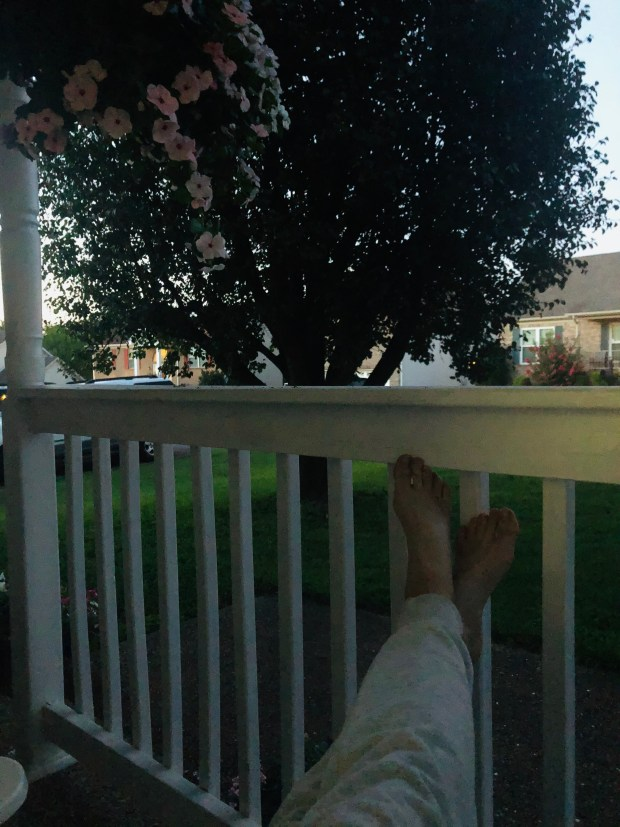Sitting on porch with flowers