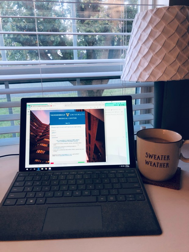 Working at desk with coffee