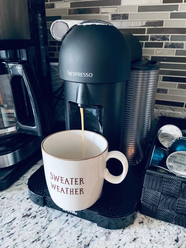 Nespresso machine and coffee mug