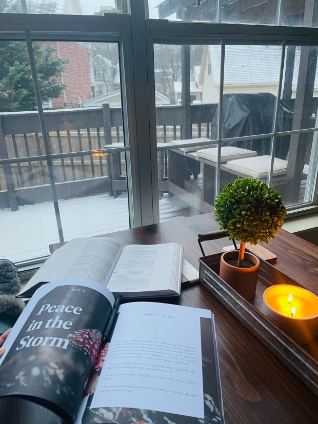 Doing devotional with candle and snow