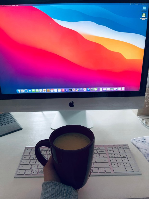 New iMac and cup of coffee