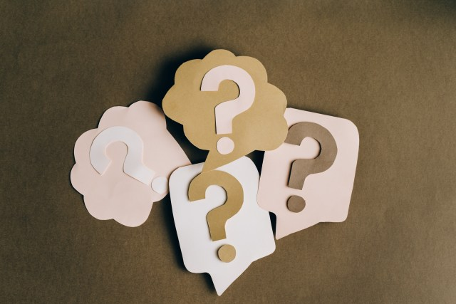 A picture of four question marks, denoting the four questions to ask before using contractions.