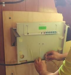 duda cable tech installing a fiber patch panel [ 1400 x 787 Pixel ]
