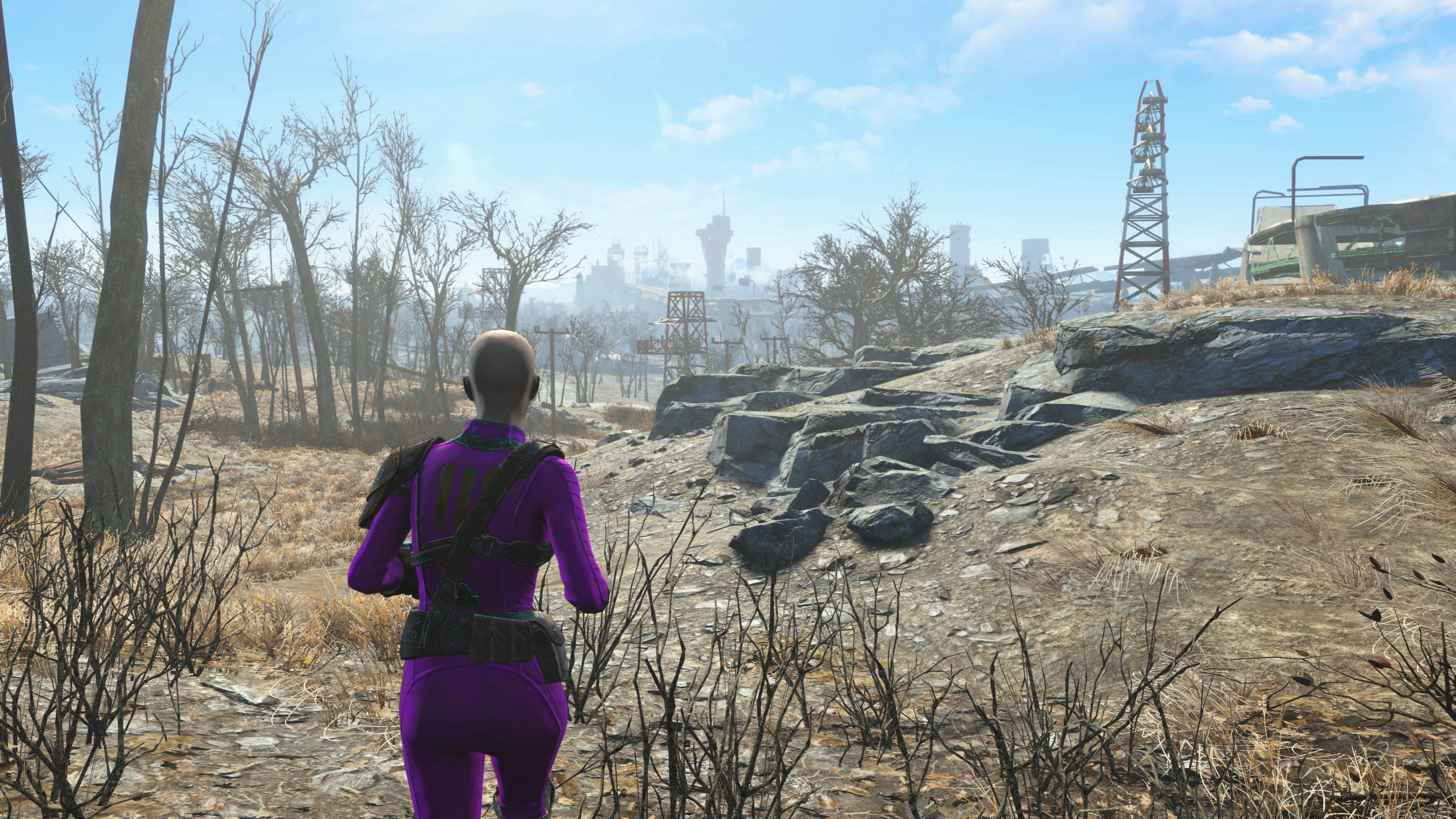 Susan's Fallout 4 character running in a barren wasteland.
