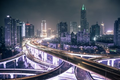 Elevated road in Shanghai. China has led the effort to establish the AIIB, holding commanding percentages of both shares and votes in the Bank. Credit to David Veksler, Flickr CC
