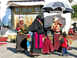 People dressed in traditional clothes selling things to visitors in Lhasa, TIbet. https://flic.kr/p/53aLZN