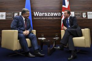 Prime Minister David Cameron and President Poroshenko of Ukraine at the NATO Summit 2016, in Warsaw, Poland