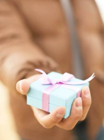 Hand-giving-a-wrapped-gift