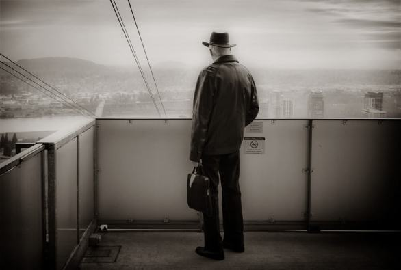 Man at top of tram