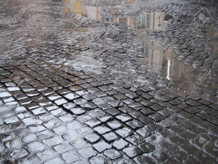 689088-cobblestone-old-street-in-rome-italy-a-view-just-after-rain