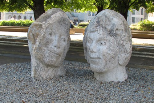 OBJECTS  Of devotion - Two stone heads looking lovingly at each other