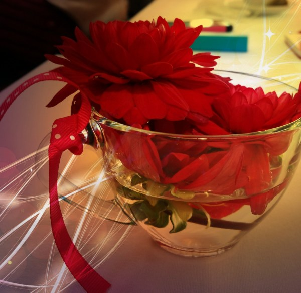 From Treasure To Triumph! - Red flowers in Glass w/ water: Treasured moments of life, light, and all that sustains us.