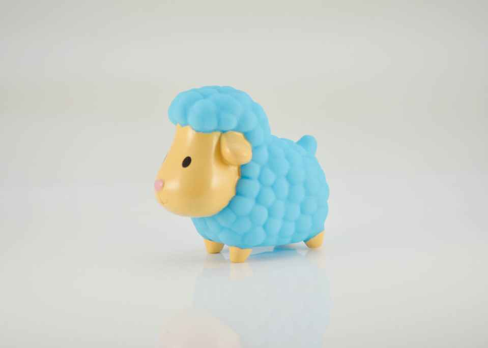 blue and yellow sheep plastic toy