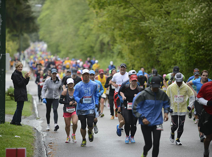 Runners in the Vancouver marathon on Camosun Street near 33rd Avenue