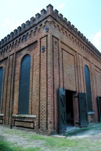 "Engine house and boiler room: ""Completed in 1855, this building housed a boiler and stationary steam engine that provided power for the extensive belt driven machinery used throughout the site..."""