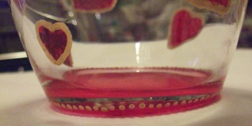 Paint gold dots around the edge of the red paint as a border.