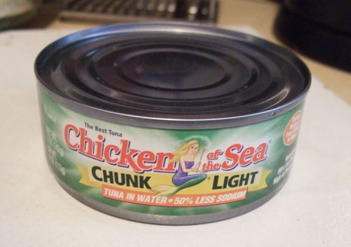Open tuna and drain water out.