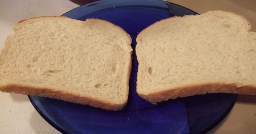 Two slices of bread. Add bbq sauce to the bread before you add the pork pieces.