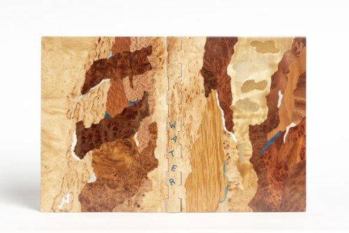 Winner: . Binding made out of pear wood covered with Karelian birch veneer. Inspired by the idea that 'water comes to us from rocks, from mother earth, but also from clouds, sometimes from tears … just a few drops that come together to form streams and lakes'.