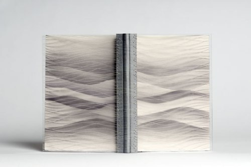 Runner-up: The pages have been divided into two bindings, 'Water' and 'Waterborn'; both featuring machine-embroidered grey Dypion-style fabric and airbrushed endpapers. The sign was inspired by the light and shade created by sun and clouds on the surface of the sea, and echoes the marbling forms in the text.