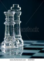 stock-photo-king-and-queen-on-the-chess-board-macro-image-of-glass-pieces-shallow-dof-focus-on-the-queen-in-1632922