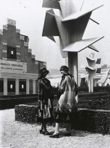Models wearing deisgns by Sonia Delaunay pose in front of Martel concrete trees + 1925