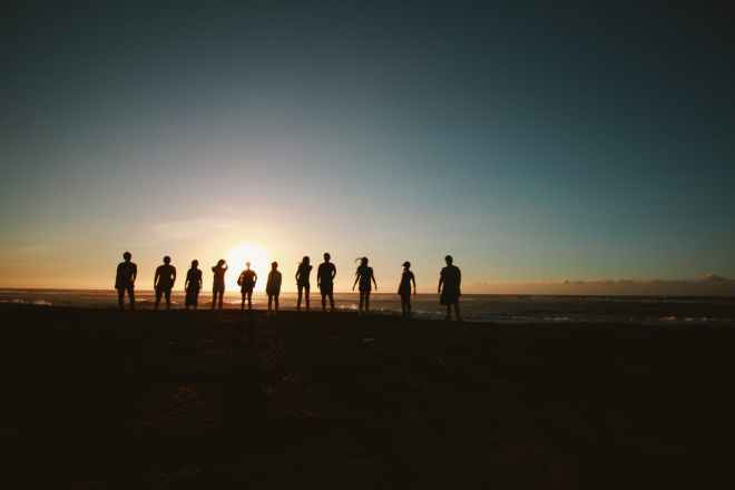 silhouette of people during sunset