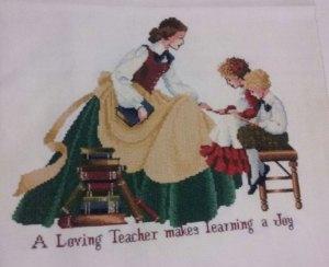 Venta de bordado a punto de cruz con dibujo de profesora y niños