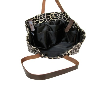 Faux giraffe fur pattern fabric tote bag with brown leather straps and black satin lining. Six internal pockets. by misp https://www.etsy.com/listing/208638581/