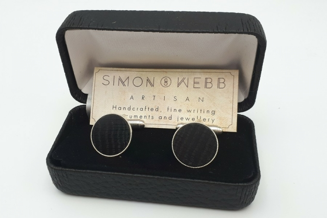 Cufflinks made from 5000 year old bog oak by Simon Webb.