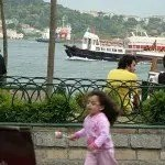 Watching boats on the Bosphorus Strait Istanbul