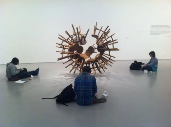 "Students gathered around ""Grapes"" by Ai Weiwei"