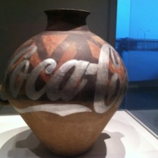 Ancient Urn Emblazoned with Coca-Cola Logo