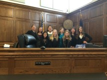 This was my all women mock trial team that competed at state in eighth grade!