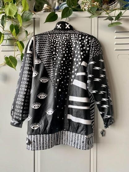 handpainted vintage leather jacket pattern black and white graphic design sustainable fashion wearable art