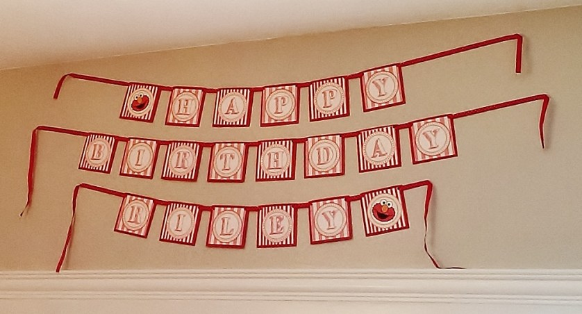 Pink & Red Elmo Birthday Party Decor with DIY Banner| missfrugalfancypants.com