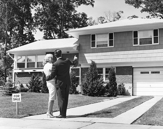 Rear view of a couple standing in front of a house. Photo by: Superstock/Everett Collection(255-41357B)