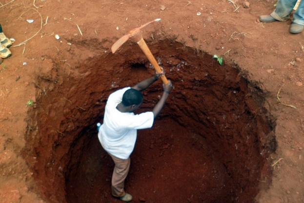 Hand digging a new water well.